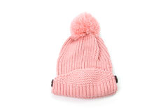 Pink knitted hat with pompom isolated on white background.  Stock Images