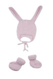 Pink knitted hat with rabbit ears and booties Stock Image