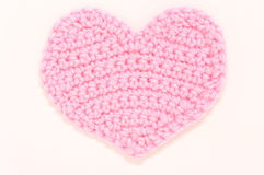 Pink knitted heart. Stock Photos
