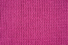 Pink knitted pattern. As a seamless background Royalty Free Stock Photo