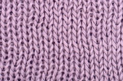 Pink knitted pullover background Stock Images