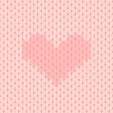 Pink knitted seamless pattern with heart Stock Image