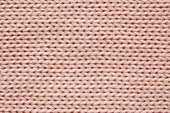 Pink knitted texture Stock Photos