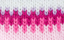 Pink knitted wool pattern Stock Images
