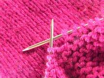 Pink Knitting. A pair of knitting needles and pink yarn Stock Photos