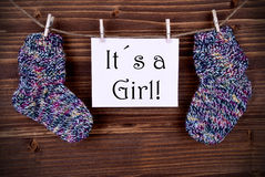 Pink Label With Baby Socks And Its A Girl Royalty Free Stock Image