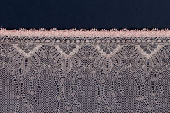 Pink lace on a dark background Royalty Free Stock Image