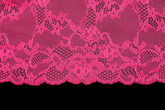 Pink lace over black background Stock Photography