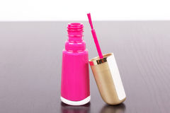 Pink lacquer with stick on table Royalty Free Stock Images