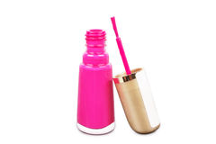 Pink lacquer with stick on table Stock Image