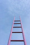 Pink ladder in the blue sky Royalty Free Stock Photography