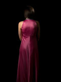 Pink lady. Attractive lady in pink silk dress back Royalty Free Stock Photography