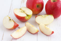 Pink lady apples cut Royalty Free Stock Image