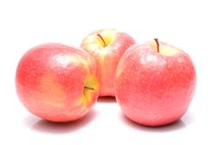 Pink Lady apples. Isolated on white background Royalty Free Stock Photos