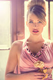 Pink lady. An attractive blonde woman in an elegant pink dress Royalty Free Stock Image