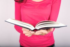 Pink lady holding book Royalty Free Stock Images