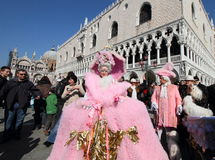 Pink lady performer and tourists at Venice carnival Royalty Free Stock Photos