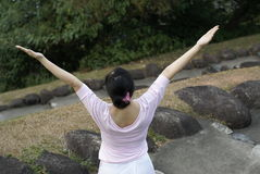 Pink lady raise arms outdoors Royalty Free Stock Image