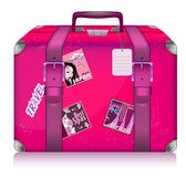 Pink ladys suitcase for travel with stickers. Stock Photography
