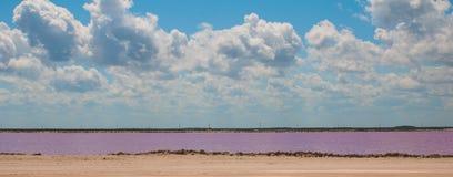 Pink lake. Striking red pool used in the production of salt near Rio Lagartos, Mexico, Yucatan.  Royalty Free Stock Photos