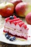 Pink layer cake decorated with fresh fruits Stock Images