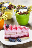 Pink layer cake decorated with fresh fruits Royalty Free Stock Photo