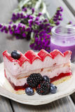 Pink layer cake decorated with fresh fruits Stock Photography