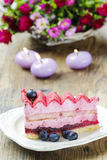 Pink layer cake decorated with fresh fruits Royalty Free Stock Photography