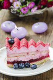 Pink layer cake decorated with fresh fruits Royalty Free Stock Image