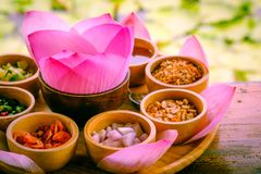 Pink leaf of lotus wrapped in a word with dried lemon, coconut,. Dessert with medicinal plants. Use pink leaf of lotus wrapped in a word with dried lemon royalty free stock images