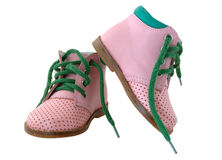 Pink leather baby's boots. Pink leather baby's boots with green shoe-laces Royalty Free Stock Photos