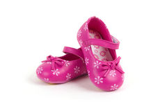 Pink leather baby shoes Royalty Free Stock Photos