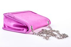 Pink leather bag with chain. Ladies stylish bag isolated on white background. Woman luxury accessory Royalty Free Stock Images
