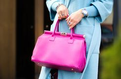 Pink leather bag in female hands. Stylish modern and feminine image, style. Bag close up