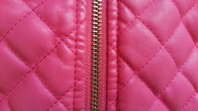 Pink leather closeup texture background. Genuine leather skin te Stock Images