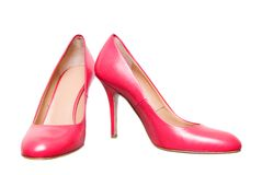Pink leather female shoes isolated on white stock photo