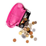 Pink leather purse and several different coins Royalty Free Stock Photos