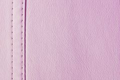 Pink leather texture. Closeup of the pink leather seam texture Stock Images