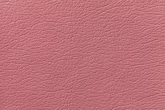 Pink leather texture background with pattern, closeup.  Stock Photos