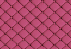The pink leather texture. Of the skin quilted sofa Stock Photography