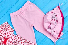 Pink leggings and hat for baby-girl. Stock Photo