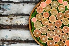 Pink lemon slices. Group of pink lemon slices on wooden background, lemons is medicine for detox, treat to cough, sore throat, a healthy food, nature medicine royalty free stock images