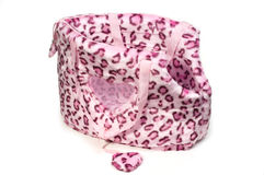 Pink leopard print bag for small dogs. Pink leopard print bag for small dogs on  white background Stock Images