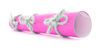 Pink letter roll tied with cord, three natural nodes isolated Royalty Free Stock Images