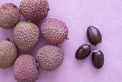 Pink lichi. S on pink background Stock Photography