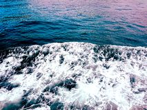Pink light reflected on sea stock photos