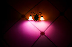 Pink Light Shine Lamp and Decorative Wall Background Royalty Free Stock Image
