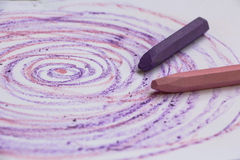 Pink and lilac crayons. Two crayons with a lilac and pink circular doodle Stock Images