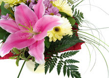 Pink lily in a bouquet with white background Stock Photo