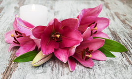 Pink lily flower and candle Stock Photography